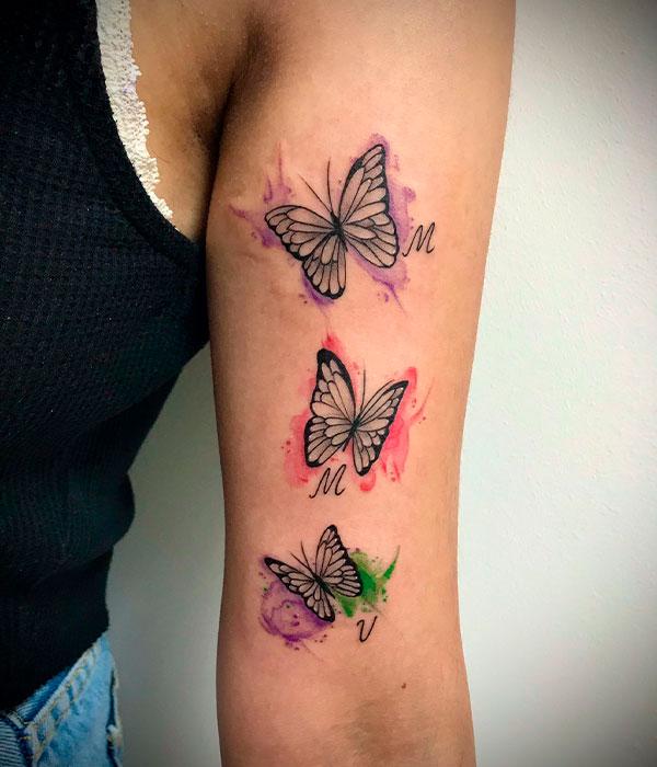 Tatuaje mariposa con acuarela en Cartagena, Murcia, De La Rocha Tattoo